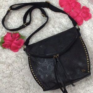 The Sak black tooled leather crossbody bag